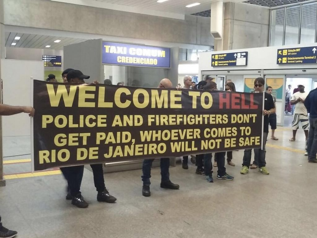 Police greet spectators at the airport