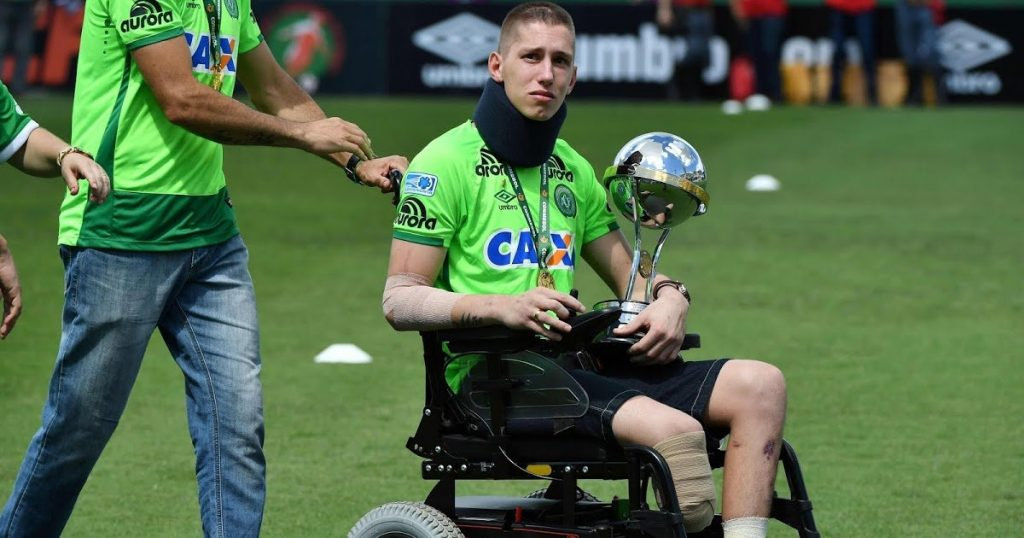 (Survivor Jackson Follman receives the trophy for the team – Source: Sporting News)