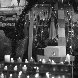 Virgin and candles, Popayán market. March 2017.