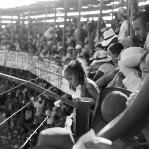 Young girl watches the bullfight on a national holiday. August 2017