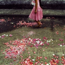 A girl walking in the street during the Virgin of the Candelaria's celebration in Ixhuatlanciyo, Veracruz, Mexico